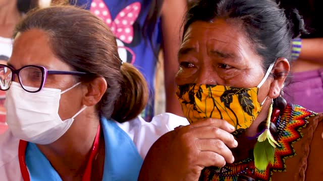 guarani indigenous pajé lidia nunes cries with joy next to nurse rosane das neve during a covid-19 vaccination campaign at the aldeia mata verde... - neve stock videos & royalty-free footage