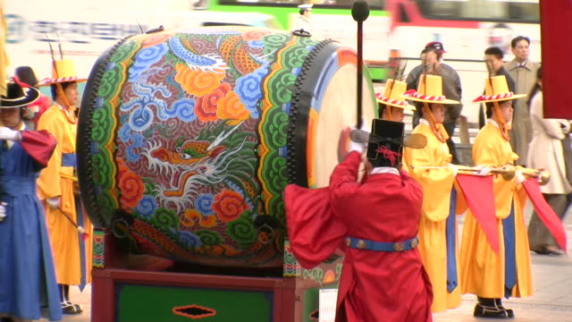 MS Guard banging drum at deoksugung royal Palace in traditional uniform / Seoul, South Korea