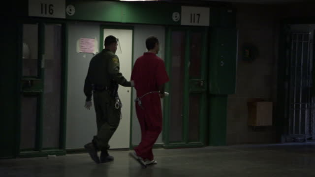 a guard escorts a prisoner. - prisoner stock videos & royalty-free footage