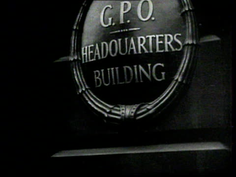 guard handing bundle tom man in suit. g.p.o. headquarters building' sign. postal workers emptying bags of mail onto conveyor belt. female hands... - holing stock videos & royalty-free footage