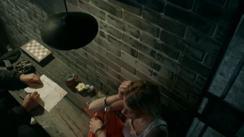 guard interrogating women in jail - legal trial stock videos & royalty-free footage