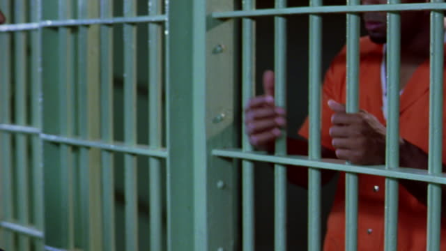 a guard lets a prisoner out of his cell. - criminal stock videos & royalty-free footage