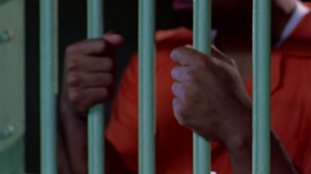 vídeos de stock, filmes e b-roll de a guard lets a prisoner out of his cell. - prisoner