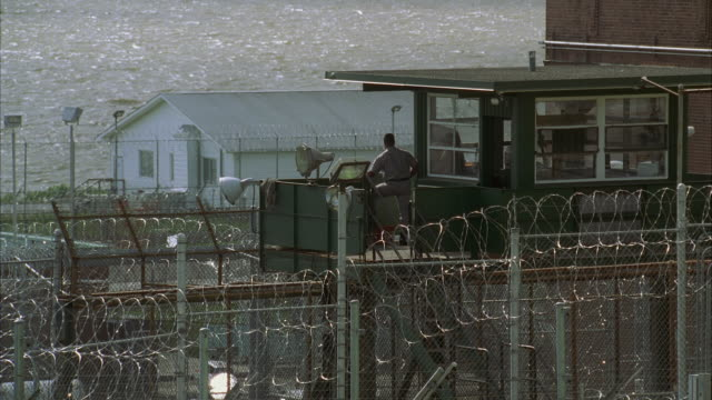 WS HA Guard on lookout tower in Sing Sing prison complex / Ossining, New York, USA