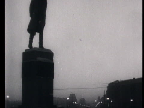 guard reads letter to the nation at the glory of stalin and calling to vote for stalin, workers in factories throughout the country and meetings,... - anno 1951 video stock e b–roll