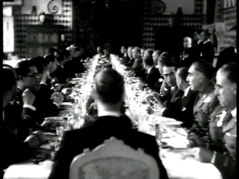 guard standing at door. men seated at long banquet table. ambassador n. franco & prime minister salazar sitting talking waiters walking by. ext... - portugal stock-videos und b-roll-filmmaterial