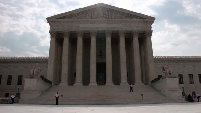 guard stands outside the u.s. supreme court on june 9, 2014 in washington, dc. the high court ruled today by 7 to 2 margin that homeowners in north... - north carolina us state stock videos & royalty-free footage