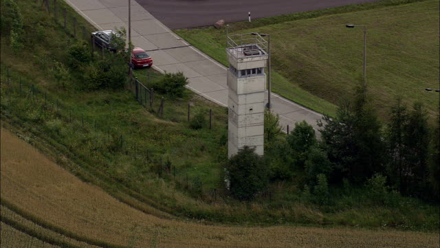 guard tower and remnant of east west german border  - aerial view - thuringia,  helicopter filming,  aerial video,  cineflex,  establishing shot,  germany - east germany stock videos and b-roll footage