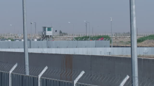 guard tower near fence of syrian refugee camp - refugee camp stock videos & royalty-free footage