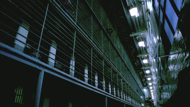 la ws guard walking along cell block balony in folsom state prison / folsom, california, usa - jail cell stock videos & royalty-free footage