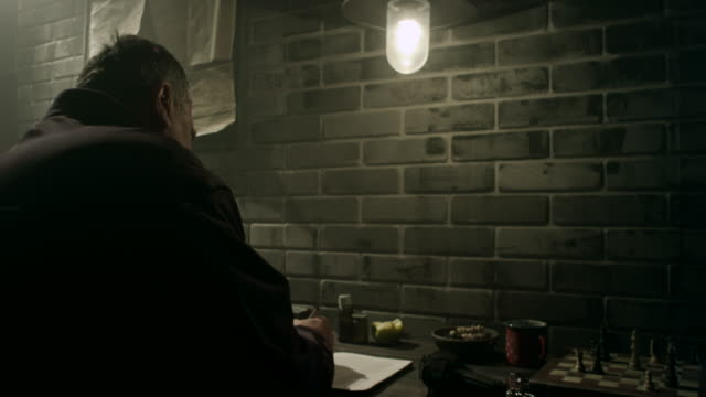 guard writing down information about convicts in prison - mp stock videos & royalty-free footage
