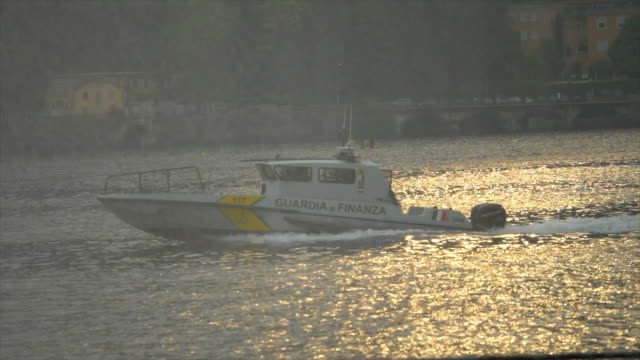 guardia di finanza police italian coast guart speed motor boat on lake como, italy, europe. - slow motion - finanza stock videos & royalty-free footage