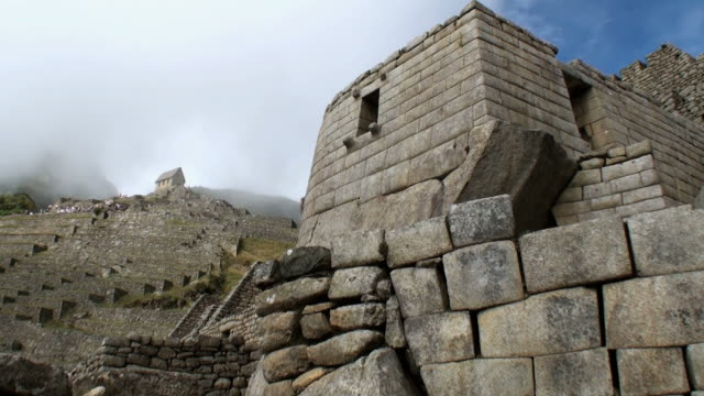 ws guardian house overlooking stone terraces / machu picchu, peru - old ruin stock videos & royalty-free footage