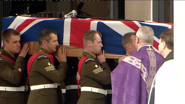 INT * * Bagpipe music heard during the following shots SOT * * Military pallbearers carrying along coffin of Major Sean Birchall Joanne Birchall...