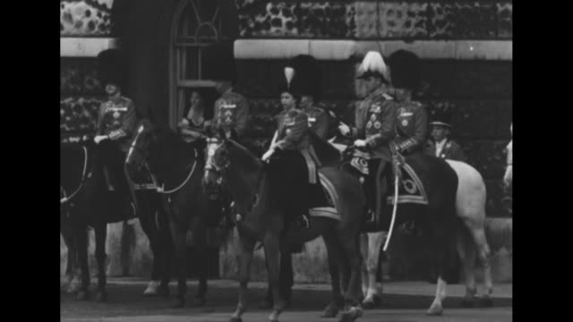 guards commanding officer rides forward / sot he asks queen elizabeth ii��s permission to march off / elizabeth on horse winston with philip, duke of... - fahnenparade stock-videos und b-roll-filmmaterial