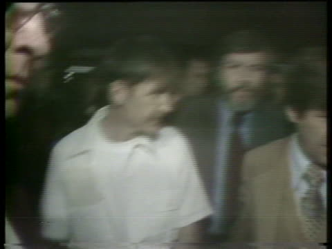 guards escort a handcuffed gary gilmore, a convicted murderer, prior to his execution by firing squad in provo, utah. - provo stock-videos und b-roll-filmmaterial
