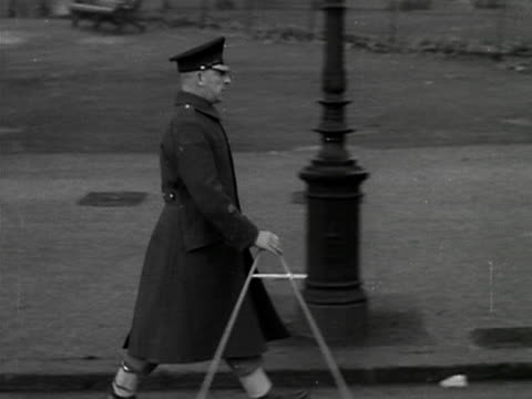 a guardsman with a pace stick walks along the mall measuring his steps in preparation for the coronation of elizabeth the second 1953 - 1953 stock videos and b-roll footage