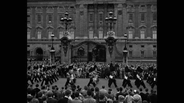 guardsmen parade outside buckingham palace, london, england - british military stock videos & royalty-free footage
