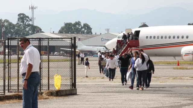 guatemalan migrants deported from the us and northern mexico walk from a plane to a processing center at an air force base in guatemala city... - central america stock videos & royalty-free footage