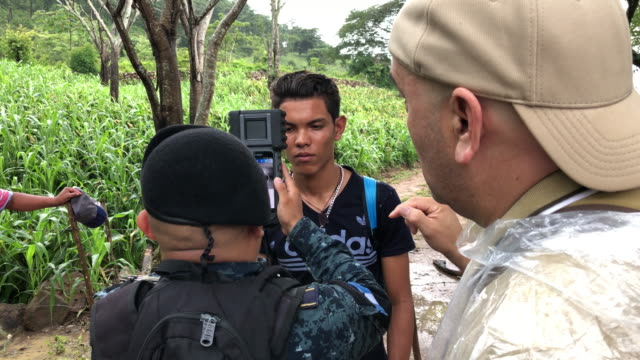 guatemalan policeman photographs an undocumented honduran immigrant while gathering data using ussupplied bitmap technology on august 27 2019 in... - ice us homeland security stock videos & royalty-free footage