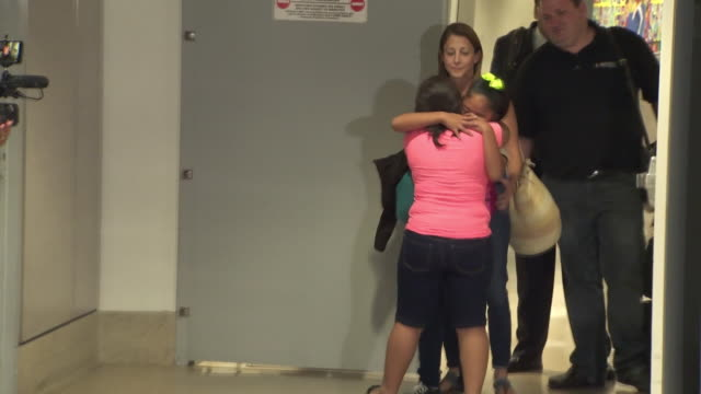 ktla guatemalan woman reunited with her 12yearold daughter at lax after month of being separated - reconciliation stock videos & royalty-free footage
