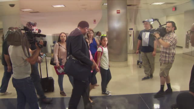 guatemalan woman reunited with her 12-year-old daughter at lax after month of being separated. - dividing stock videos & royalty-free footage