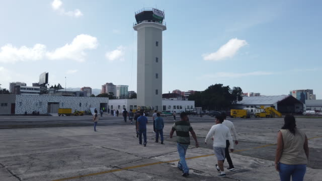 guatemalans arrive on an ice deportation flight from brownsville texas on august 29 2019 to guatemala city under a new policy ice has expedited... - deportation stock videos & royalty-free footage