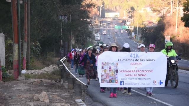 guatemalans on wednesday took part in a 41 kilometre march to remember and demand justice for the victims of a fire at a children's shelter last... - kilometre stock videos & royalty-free footage