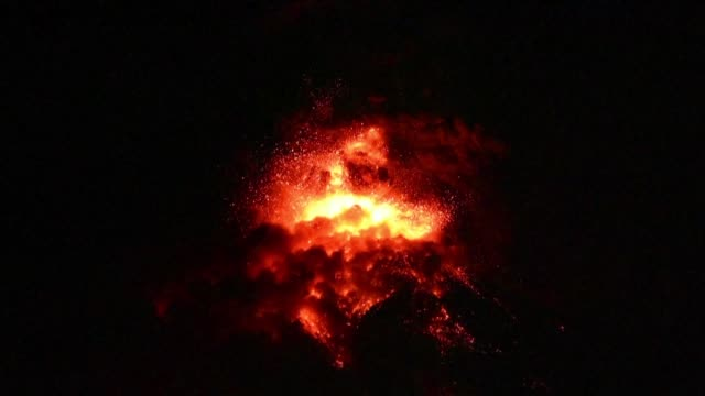 guatemala's fuego volcano erupts during the night for the fifth time this year spewing lava and ash into the air - guatemala stock videos & royalty-free footage