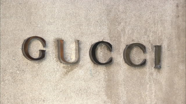 cu, gucci sign on building exterior, madison avenue, new york city, new york, usa - intellectual property stock videos & royalty-free footage