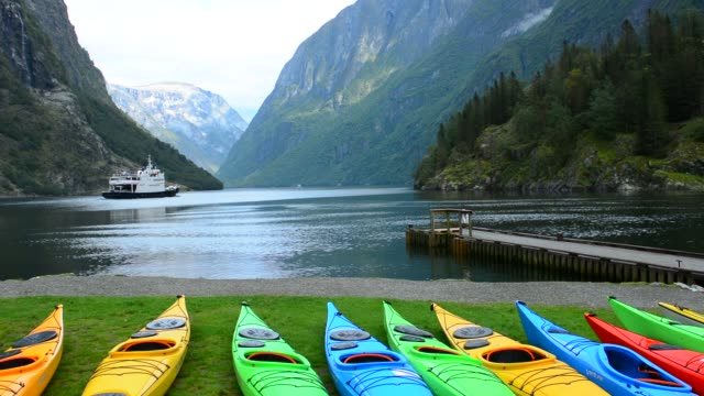 Gudvangen Norway fabulous fjord called Naeroyforden Fjord with colorful kayaks in water