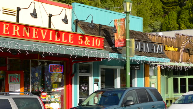 guerneville calfornia main street of small hippy town shows 5 & 10 store western in russian river valley sonoma county logging area with cars - ladenschild stock-videos und b-roll-filmmaterial
