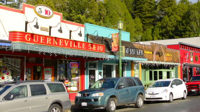 Guerneville Calfornia Main Street of small hippy town shows 5 & 10 store western in Russian River Valley Sonoma County logging area with cars