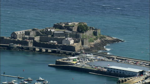 guernsey,  castle cornet - aerial view - helicopter filming,  aerial video,  cineflex,  establishing shot - channel islands england stock videos & royalty-free footage