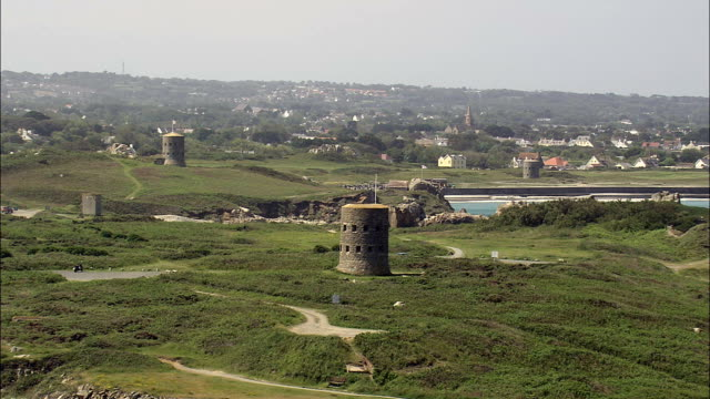 guernsey watch towers - aerial view - helicopter filming,  aerial video,  cineflex,  establishing shot,  guernsey - channel islands england stock videos & royalty-free footage