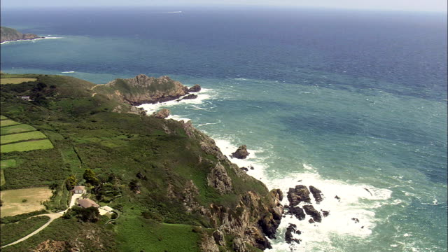 guernsey's south coast  - aerial view - helicopter filming,  aerial video,  cineflex,  establishing shot,  guernsey - channel islands england stock videos & royalty-free footage