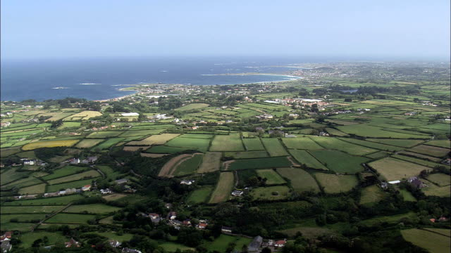 guernsey's south west peninsula  - aerial view - torteval,  helicopter filming,  aerial video,  cineflex,  establishing shot,  guernsey - guernsey stock videos & royalty-free footage