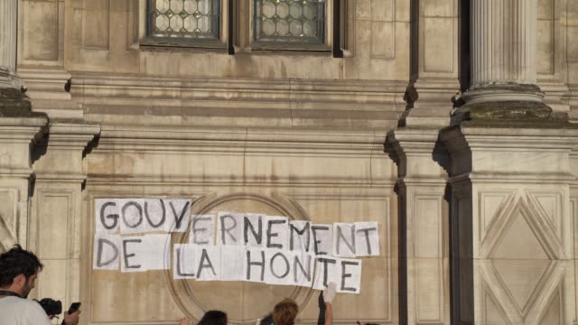 "guerrilla feminists papered city hall in paris to protest against macron's new cabinet with signs stating ""rise up women!"", ""bring on the... - {{relatedsearchurl(carousel.phrase)}} video stock e b–roll"