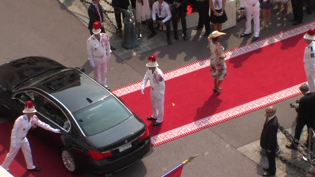 guest arrives at palace at the monaco royal wedding religious ceremony arrivals at monaco - royal palace monaco stock videos and b-roll footage