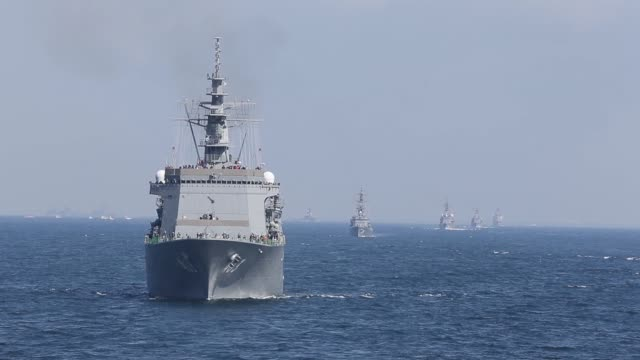 guest attendees ride on a japanese maritime self defense force vessel during a review at sagami bay off yokosuka kanagawa prefecture japan on sunday... - japan self defense forces stock videos and b-roll footage