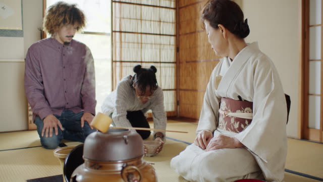 guest drinking at traditional japanese tea ceremony - washitsu stock videos and b-roll footage