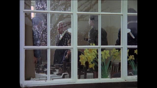 MONTAGE Guest gathering inside house / men arriving for party / United Kingdom