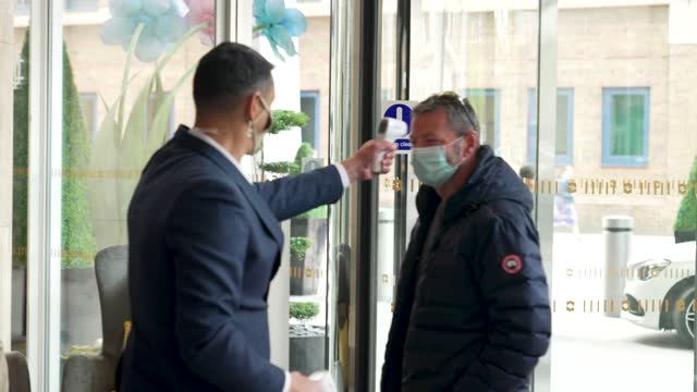 guest has his temperature checked as he arrives at the shangri-la hotel at the shard as it re-opens to the public on may 17, 2021 in london, england.... - pattern stock videos & royalty-free footage