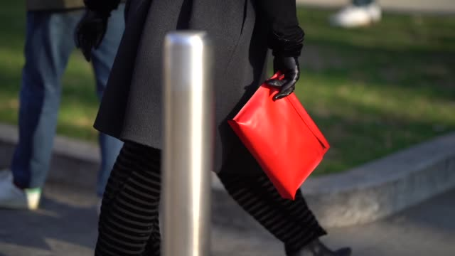 a guest holds a red clutch during milan menswear fashion week fall/winter 2018/19 on january 13 2018 in milan italy - borsetta video stock e b–roll