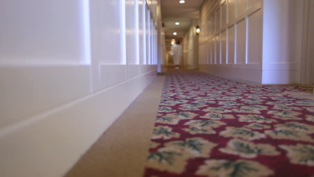 ds guest in bathrobe and slippers walking down hallway of hotel / stowe, vermont, united states - slipper stock videos and b-roll footage