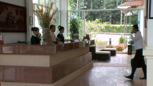 MS ZI Guest inquiry at front desk of exotic luxury hotel / Sihanoukville, Cambodia