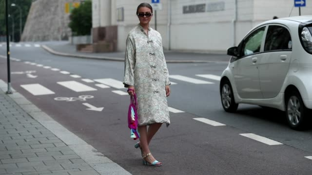 guest is seen wearing a white dress during oslo fashion on august 28, 2019 in oslo, norway. - white dress stock videos & royalty-free footage