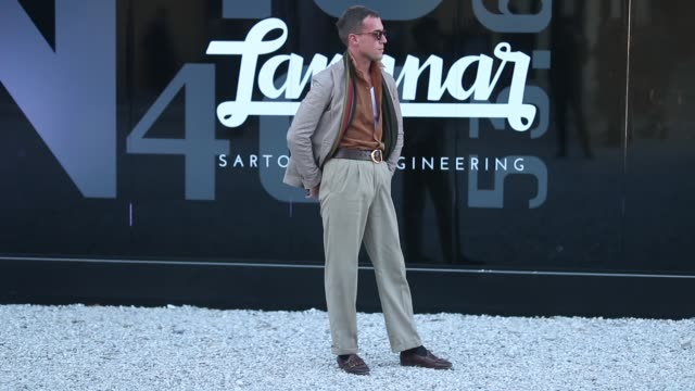 a guest is seen wearing beige grey pants and jacket sunglasses leather shoes during the 95th pitti uomo at fortezza da basso on january 10 2019 in... - grey jacket stock videos and b-roll footage