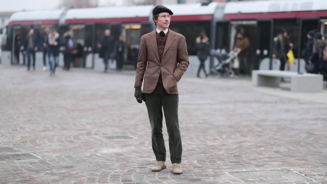 a guest is seen wearing flat cap brown blazer tie gloves glasses during the 95th pitti uomo at fortezza da basso on january 9 2019 in florence italy - flat cap stock videos & royalty-free footage