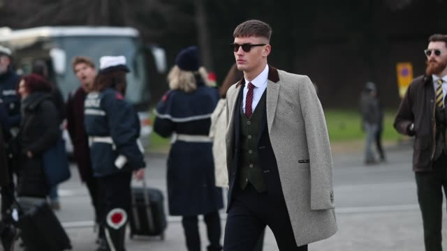 a guest is seen wearing grey coat black suit white button shirt tie sunglasses during the 95th pitti uomo at fortezza da basso on january 9 2019 in... - suit stock videos & royalty-free footage